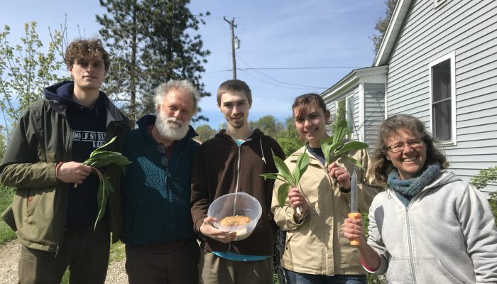 Amy Newday and students in her Slow Farming Senior Seminar with their foraged food