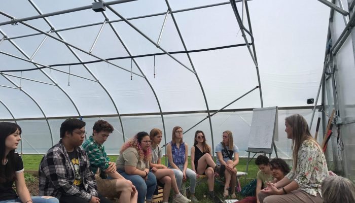 Dr. Binney Girdler leading a discussion in the hoophouse about ecology of gardens