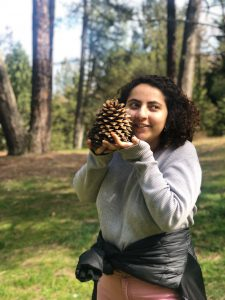 Yasi cradling a large pinecone